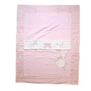 Copertina per culla rosa con striscia decorativa bianca e fiocco rosa