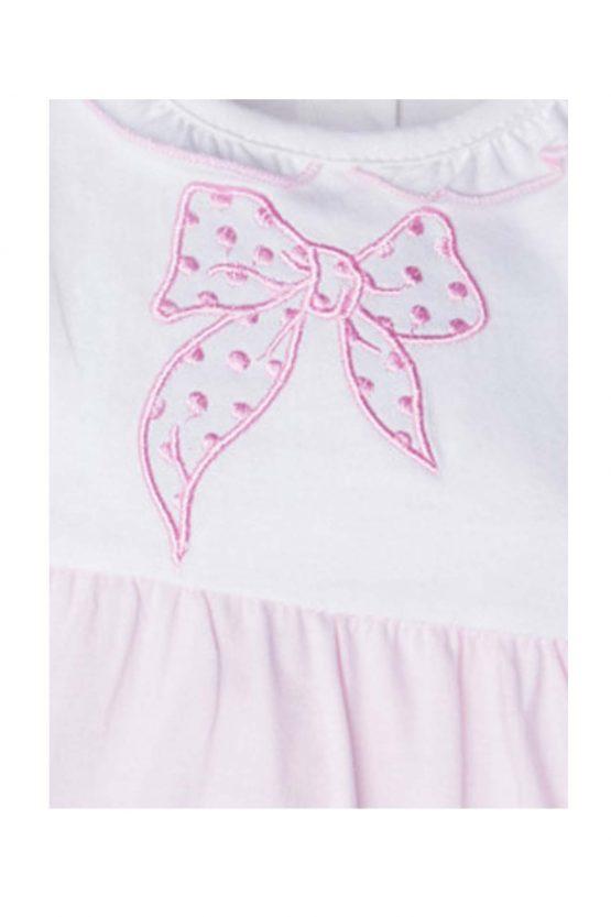 Dettaglio tutina bicolore bianco rosa fiocco ricamato